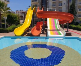The surface of the water slides in the outdoor pool was repaired and repainted